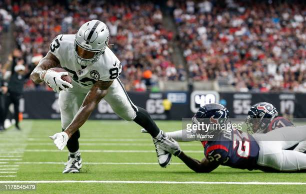 Darren Waller of the Oakland Raiders dives for a touchdown defended by Gareon Conley of the Houston Texans in the second quarter at NRG Stadium on...