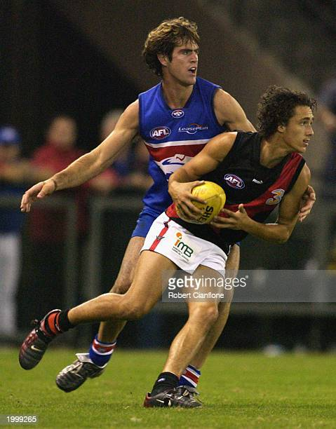 Darren Walsh of the Bombers gets away from his opponent during the round four AFL Premiership Cup match between the Western Bulldogs and the Essendon...