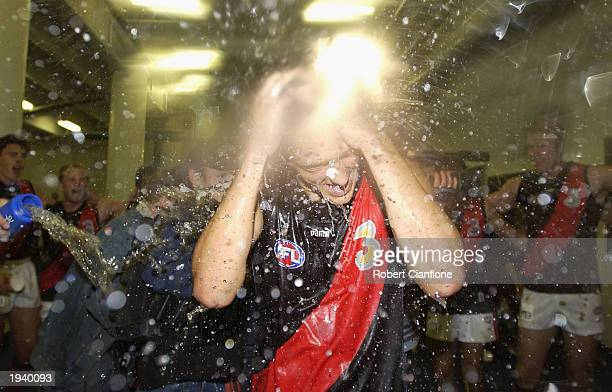 Darren Walsh of the Bombers is soaked by teammates after playing his first game and after winning the AFL Round four Premiership Cup match between...