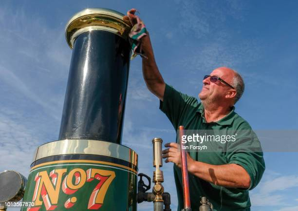 Darren Ward from Huddersfield polishes the brasses on his 1905 Yorkshire Steam Wagon during the final day of the Whitby Traction Engine Rally on...