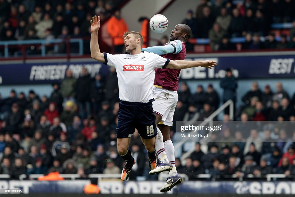 Darren Ward of Millwall takes on Carlton Cole of West Ham during the npower Championship match between West Ham United and Millwall, at Boleyn Ground on February 04, 2012 in London, England.