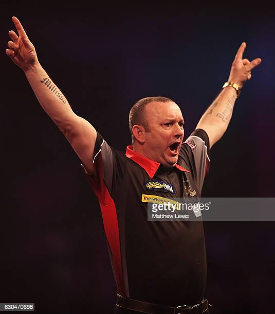 Darren Webster of Great Britain celebrates his win against Simon Whitlock of Australia during day nine of the 2017 William Hill PDC World Darts...