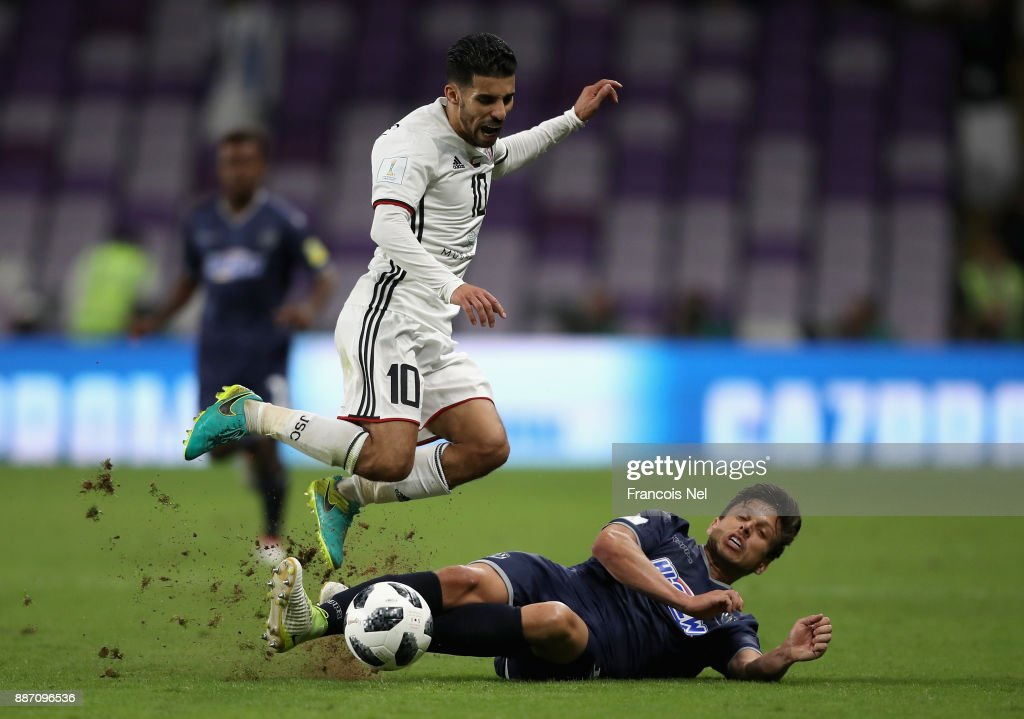 Darren White of Auckland City FC tackles Mbark Boussoufa of Al-Jazira during the FIFA Club World Cup UAE 2017 play off match between Al Jazira and Auckland City FC at on December 6, 2017 in Al Ain, United Arab Emirates.