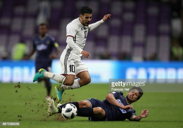 Darren White of Auckland City FC tackles Mbark Boussoufa of AlJazira during the FIFA Club World Cup UAE 2017 play off match between Al Jazira and...