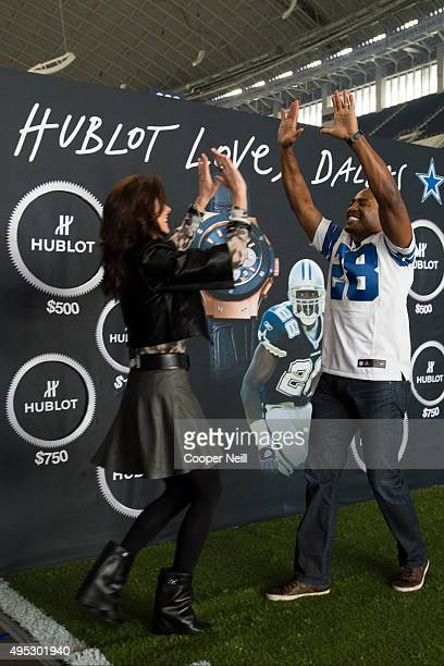 Darren Woodson and Charlotte Jones Anderson celebrate after finishing a football toss for charity as Hublot unveils the Big Bang Dallas Cowboys...