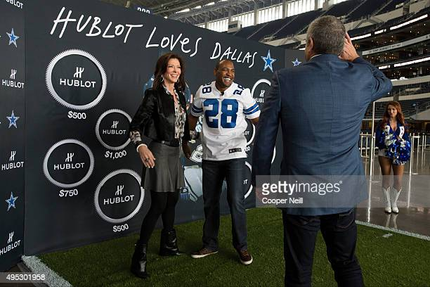 Darren Woodson and Charlotte Jones Anderson celebrate after finishing a football toss for charity with Ricardo Guadalupe as Hublot unveils the Big...