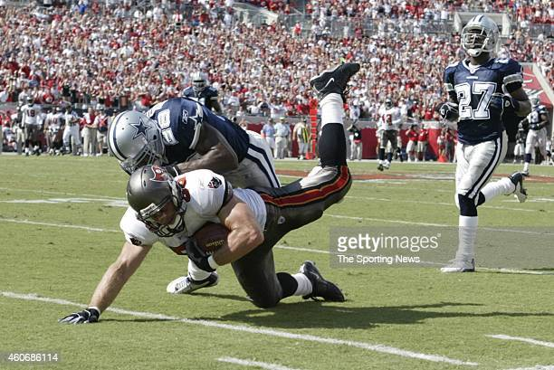 Darren Woodson of the Dallas Cowboys makes a tackle during a game against the Tampa Bay Buccaneers on October 26 2003 at the Raymond James Stadium in...