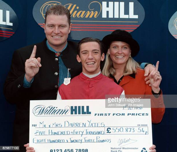 Darren Yates whose accumulator bet won him 55082354p pictured here with his wife Annaley and jockey Frankie Dettori who won all seven of his races at...