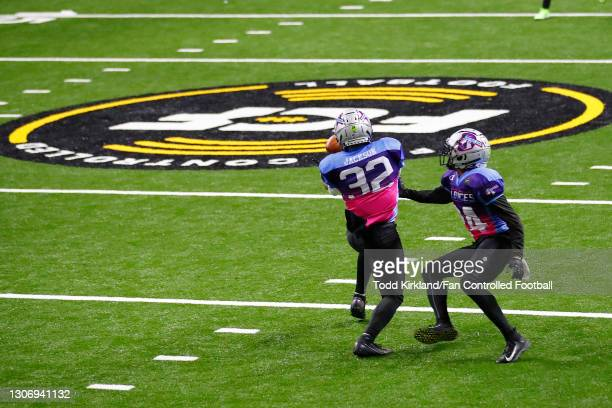 Darreon Jackson of the Wild Aces intercepts a pass against the Zappers during a Fan Controlled Football game at Infinite Energy Arena on March 13,...