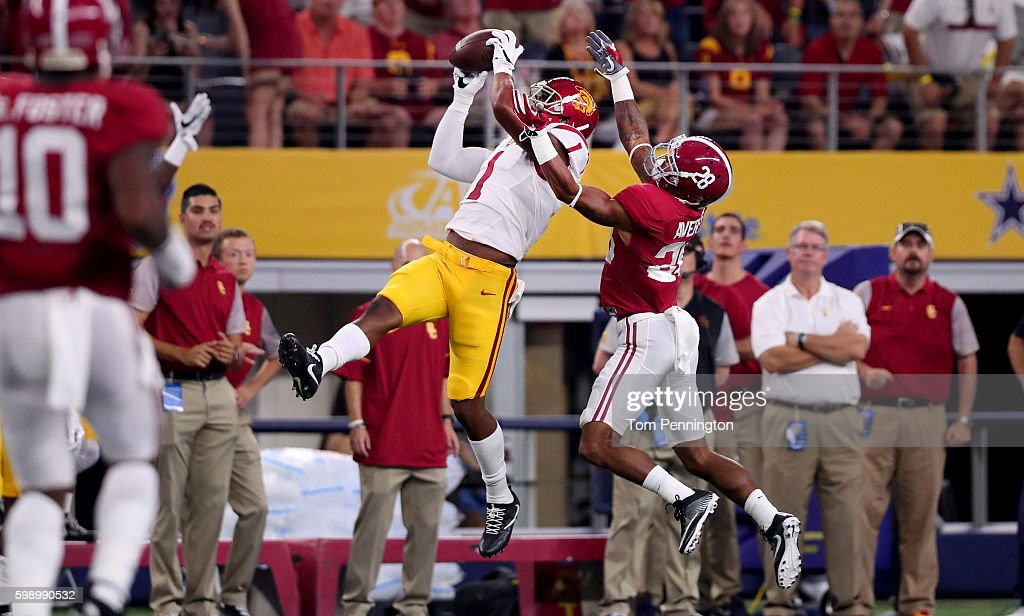 Darreus Rogers #1 of the USC Trojans catches a pass against Anthony Averett #28 of the Alabama Crimson Tide in the first quarter during the AdvoCare Classic at AT&T Stadium on September 3, 2016 in Arlington, Texas.