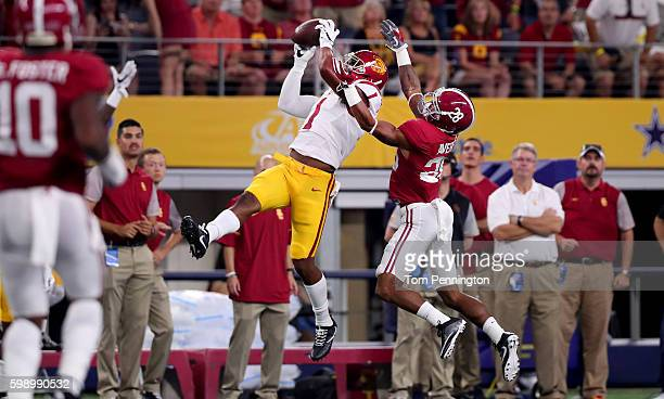 Darreus Rogers of the USC Trojans catches a pass against Anthony Averett of the Alabama Crimson Tide in the first quarter during the AdvoCare Classic...