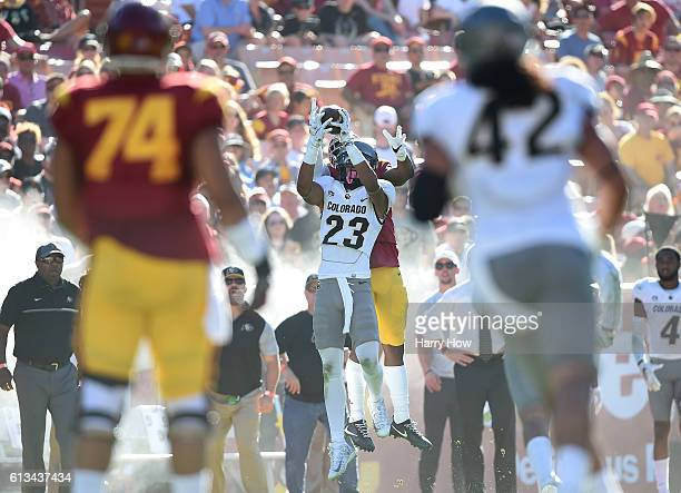 Darreus Rogers of the USC Trojans makes a catch over Ahkello Witherspoon of the Colorado Buffaloes for a first down during the fourth quarter at Los...