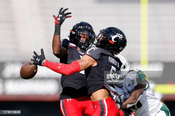 Darrick Forrest and Ahmad Gardner of the Cincinnati Bearcats defend a pass in the first quarter of the game against the South Florida Bulls at...
