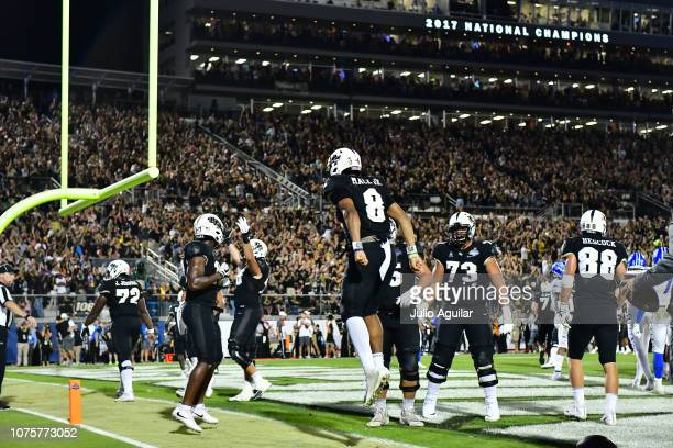 Darriel Mack Jr #8 of the UCF Knights celebrates after running in a touchdown in the fourth quarter of the American Athletic Championship against the...