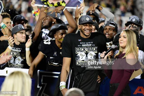 Darriel Mack Jr #8 of the UCF Knights smiles during an interview for winning the American Athletic Championship MVP after defeating the Memphis...