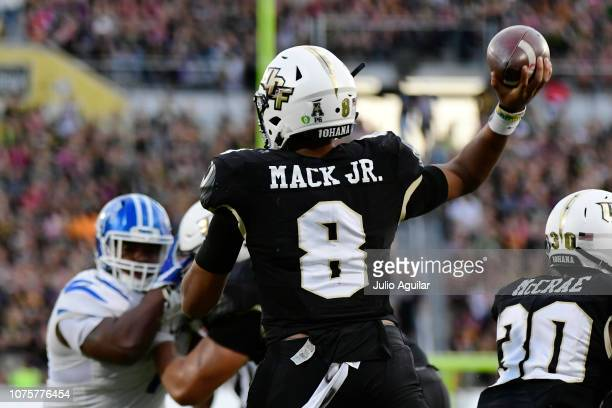 Darriel Mack Jr #8 of the UCF Knights throws a pass during the second quarter of the American Athletic Championship against the Memphis Tigers at...