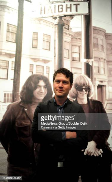 Darrin Alfred curator of the The Psychedelic Experience Rock Posters from the San Francisco Bay Area 196571 at the Denver Art Museum poses in front...