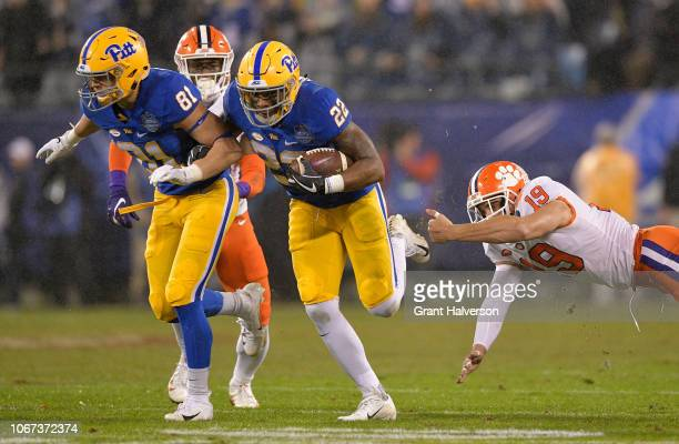 Darrin Hall of the Pittsburgh Panthers runs the ball against Tanner Muse of the Clemson Tigers in the first quarter during their game at Bank of...