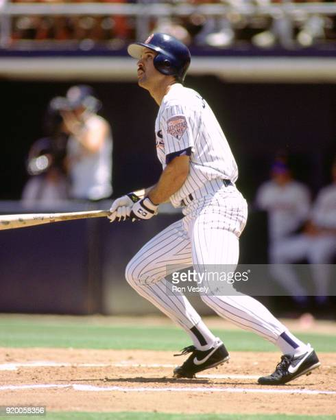 Darrin Jackson of the San Diego Padres bats during an MLB game at Jack Murphy Stadium in San Diego California during the 1992 season