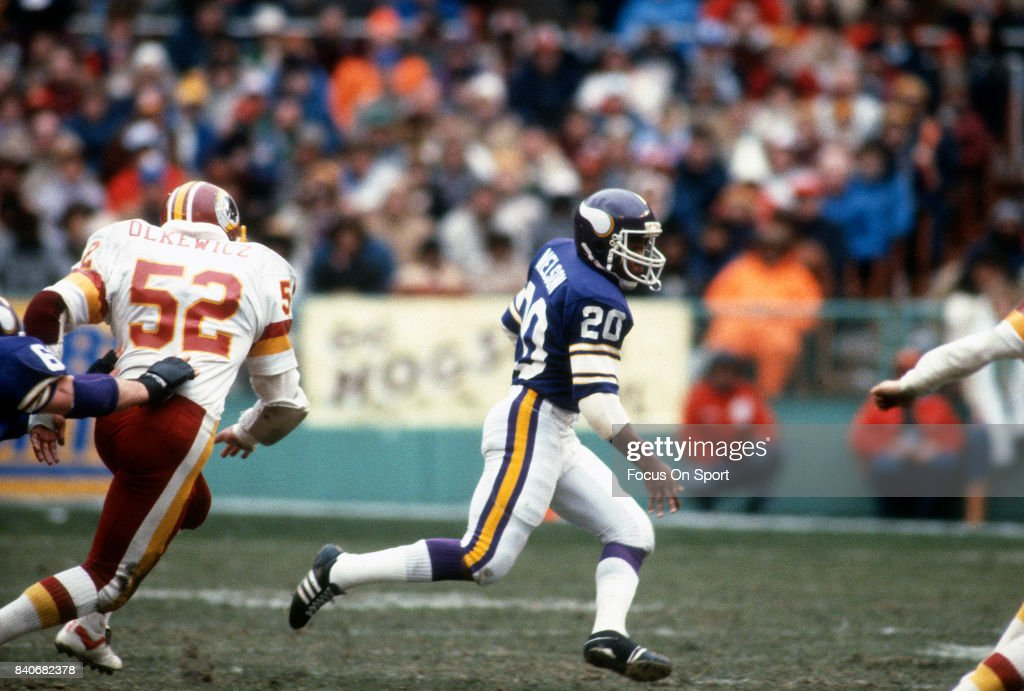 Darrin Nelson of the Minnesota Vikings carries the ball against the Washington Redskins during the NFC Divisional Playoff Game January 15 1983 at RFK...