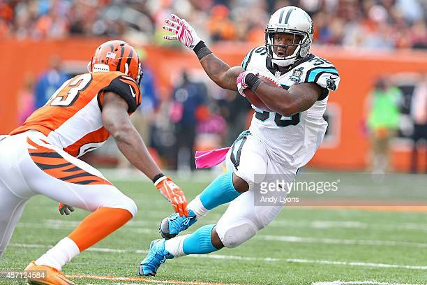 Darrin Reaves of the Carolina Panthers attempts to run the ball past George Iloka of the Cincinnati Bengals during third quarter at Paul Brown...