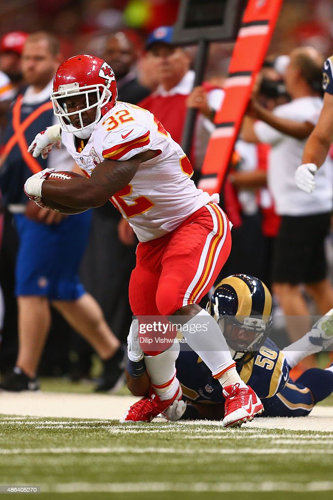 Darrin Reaves #32 of the Kansas City Chiefs carries the ball against the St. Louis Rams in the second quarter during a pre-season game at the Edward Jones Dome on September 3, 2014 in St. Louis, Missouri.