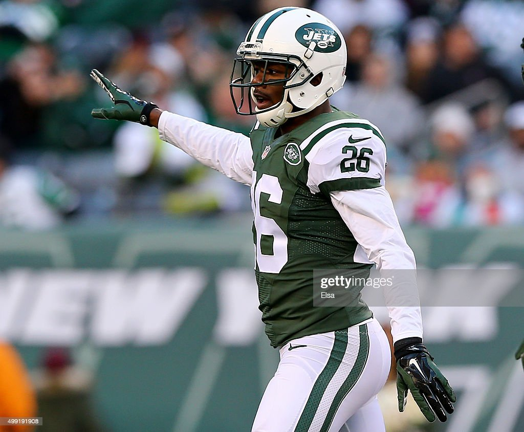 Darrin Walls #26 of the New York Jets celebrates after he broke up a pass intended for DeVante Parker #11 of the Miami Dolphins on November 29, 2015 at MetLife Stadium in East Rutherford, New Jersey.