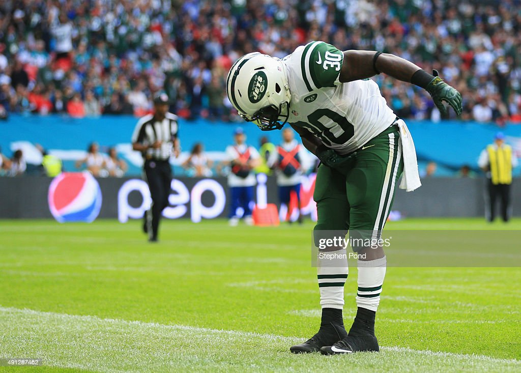 Darrin Walls #30 of the New York Jets takes a bow in celebration as he scores their third touchdown during the game against Miami Dolphins at Wembley Stadium on October 4, 2015 in London, England.
