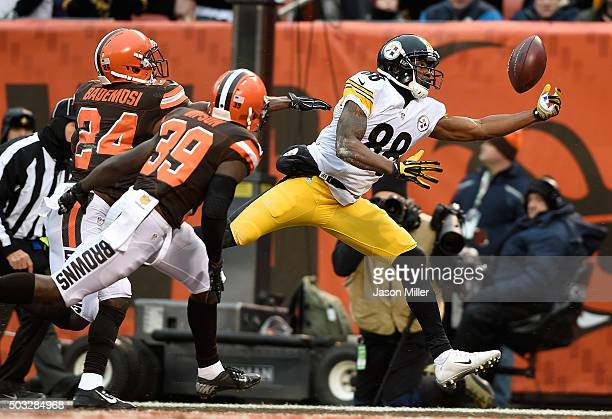 Darrius HeywardBey of the Pittsburgh Steelers can't make a catch in front of Johnson Bademosi and Tashaun Gipson of the Cleveland Browns during the...