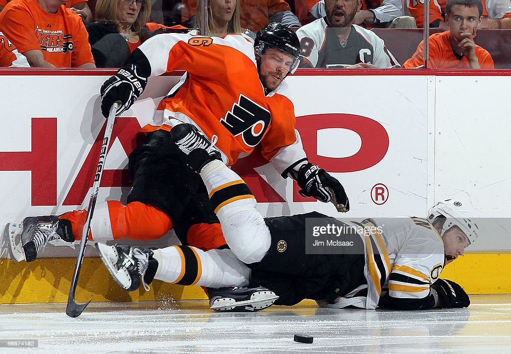 Darroll Powe #36 of the Philadelphia Flyers gets tangled up with Dennis Wideman #6 of the Boston Bruins in Game Three of the Eastern Conference Semifinals during the 2010 NHL Stanley Cup Playoffs at the Wachovia Center on May 5, 2010 in Philadelphia, Pennsylvania. The Bruins defeated the Flyers 4-1 to take a three games to one lead in the series.