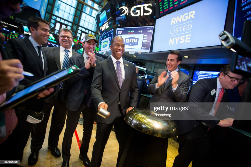 Darron Anderson, president and chief executive officer of Ranger Energy Services Inc., center, rings a ceremonial bell during the company's initial public offering (IPO) on the floor of the New York Stock Exchange (NYSE) in New York, U.S., on Friday, Aug. 11, 2017. U.S. stocks halted a three-day slide, volatility eased and Treasuries slipped as markets began to stabilize after a week of verbal sparring between the U.S. and North Korea. Photographer: Michael Nagle/Bloomberg via Getty Images
