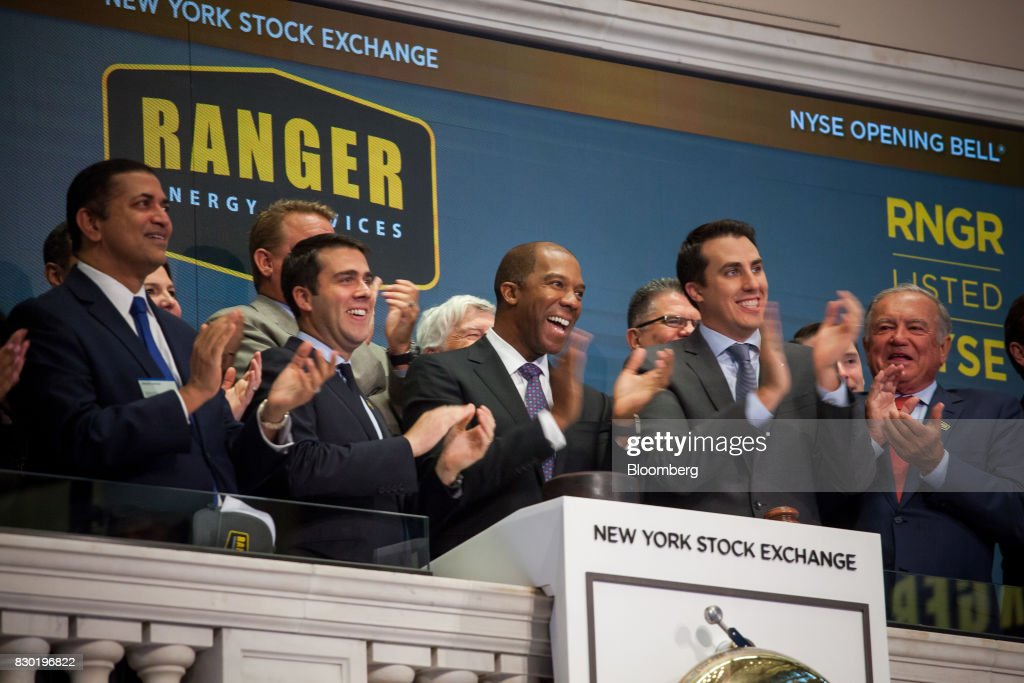 Darron Anderson, president and chief executive officer of Ranger Energy Services Inc., center, applauds after ringing the opening bell before the company's initial public offering (IPO) on the floor of the New York Stock Exchange (NYSE) in New York, U.S., on Friday, Aug. 11, 2017. U.S. stocks halted a three-day slide, volatility eased and Treasuries slipped as markets began to stabilize after a week of verbal sparring between the U.S. and North Korea. Photographer: Michael Nagle/Bloomberg via Getty Images