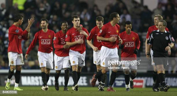 Darron Gibson of Manchester United celebrates after scoring their second goal with his team mates during the FA Cup sponsored by eon Fifth Round...
