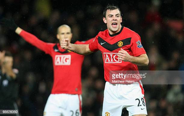 Darron Gibson of Manchester United celebrates scoring their first goal during the Carling Cup Quarter Final match between Manchester United and...