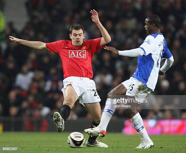 Darron Gibson of Manchester United clashes with Aaron Mokoena of Blackburn Rovers during the Carling Cup QuarterFinal match between Manchester United...