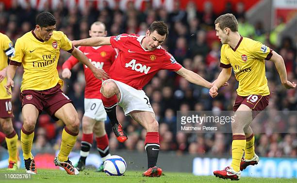 Darron Gibson of Manchester United clashes with Denilson and Jack Wilshere of Arsenal during the FA Cup sponsored by Eon 6th Round match at Old...