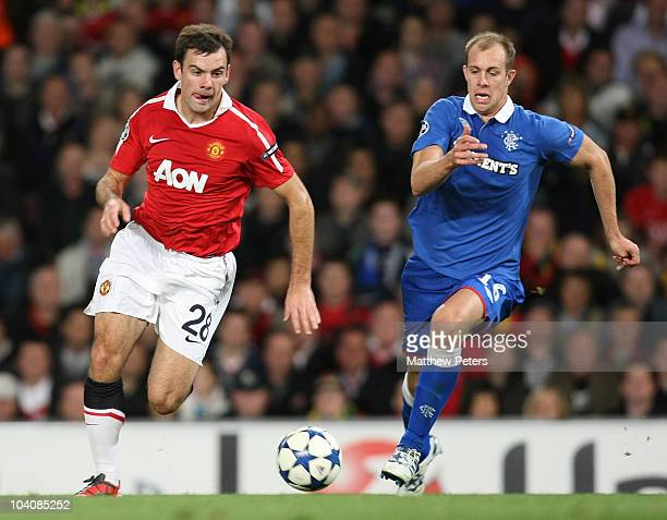 Darron Gibson of Manchester United clashes with Steven Whittaker of Glasgow Rangers during the UEFA Champions League Group C match between Manchester...