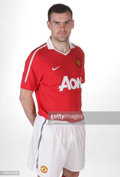 Darron Gibson of Manchester United poses in the new Manchester United home kit for the 2010/2011 season on April 14 2010 in Manchester England