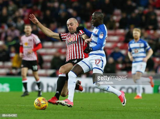 Darron Gibson of Sunderland challenges Modou Barrow of Reading during the Sky Bet Championship match between Sunderland and Reading at Stadium of...