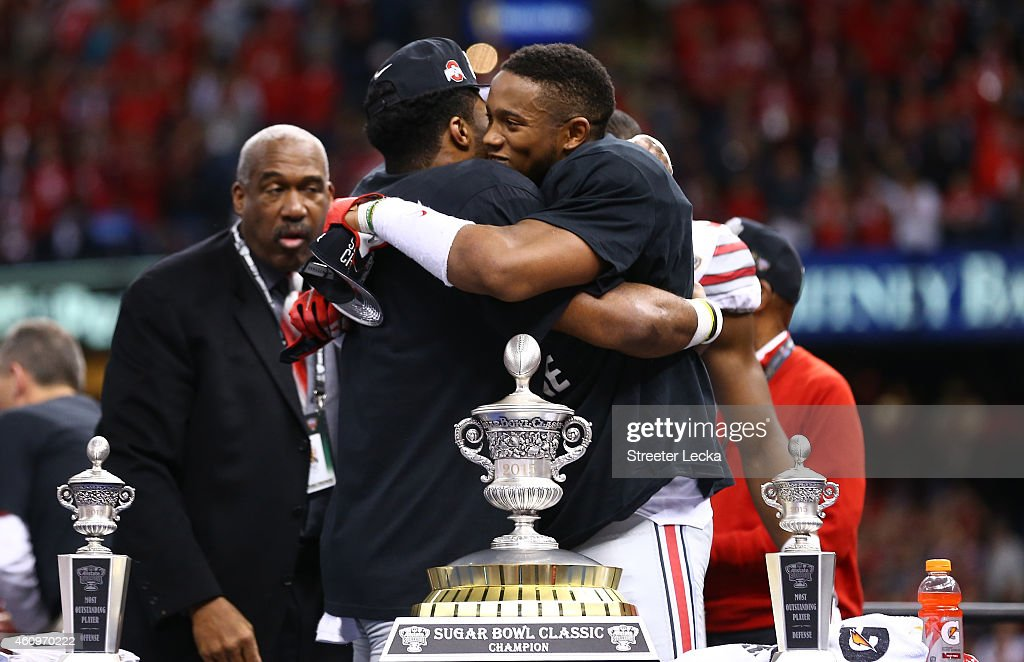 Darron Lee #43 and Ezekiel Elliott #15 of the Ohio State Buckeyes celebrate with the trophy after defeating the Alabama Crimson Tide in the All State Sugar Bowl at the Mercedes-Benz Superdome on January 1, 2015 in New Orleans, Louisiana. The Ohio State Buckeyes defeated the Alabama Crimson Tide 42 to 35.