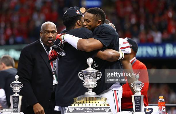 Darron Lee and Ezekiel Elliott of the Ohio State Buckeyes celebrate with the trophy after defeating the Alabama Crimson Tide in the All State Sugar...