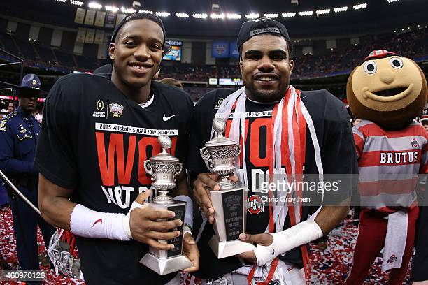 Darron Lee and Ezekiel Elliott of the Ohio State Buckeyes celebrates with the trophy after defeating the Alabama Crimson Tide in the All State Sugar...