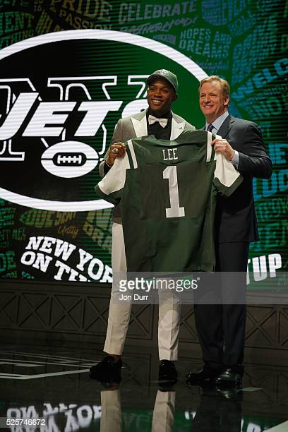 Darron Lee of Ohio State holds up a jersey with NFL Commissioner Roger Goodell after being picked overall by the New York Jets during the first round...