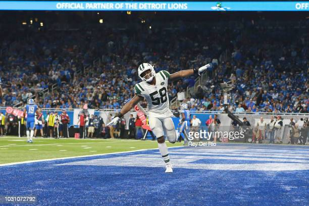 Darron Lee of the New York Jets celebrates a play in the second half against the Detroit Lions at Ford Field on September 10 2018 in Detroit Michigan