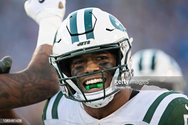 Darron Lee of the New York Jets celebrates with a smile during a game against the Tennessee Titans at Nissan Stadium on December 2 2018 in...