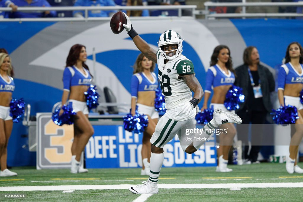Darron Lee #58 of the New York Jets intercepts the ball, runs it in for a touchdown in the second half against the Detroit Lions at Ford Field on September 10, 2018 in Detroit, Michigan.