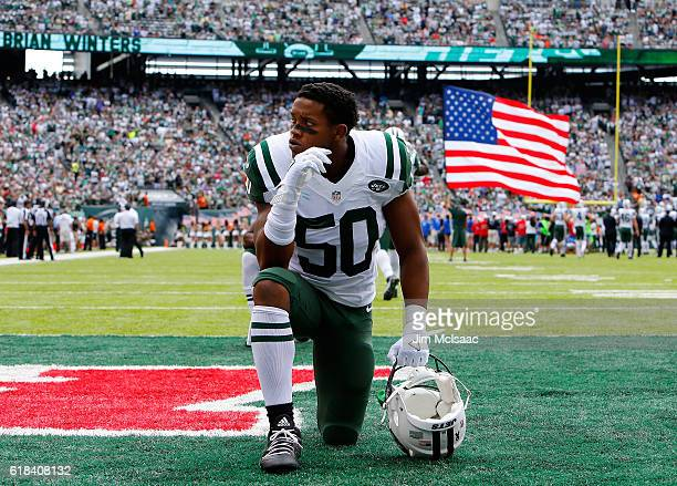 Darron Lee of the New York Jets looks on before a game against the Cincinnati Bengals on September 11 2016 at MetLife Stadium in East Rutherford New...