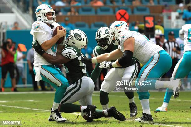 Darron Lee of the New York Jets sacks Jay Cutler of the Miami Dolphins during a game against the New York Jets at Hard Rock Stadium on October 22...
