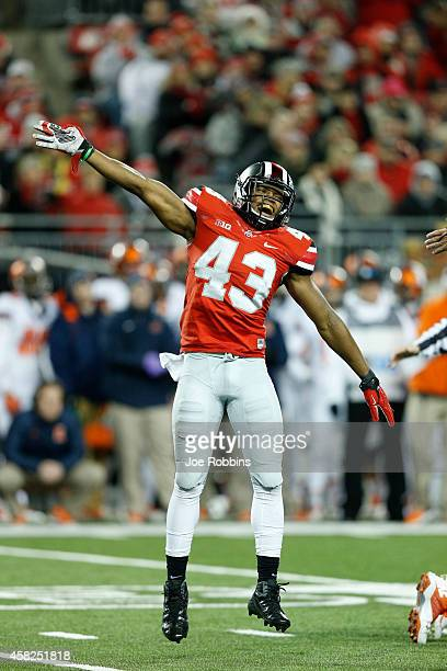 Darron Lee of the Ohio State Buckeyes celebrates after a fumble by the Illinois Fighting Illini in the first half of the game at Ohio Stadium on...