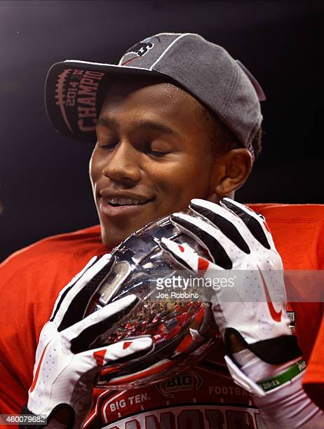 Darron Lee of the Ohio State Buckeyes celebrates with the Stagg Championship Trophy after his team defeated the Wisconsin Badgers 590 in the Big Ten...